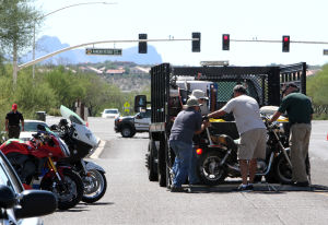 Motorcycle Accident Class: A motorcycle is loaded onto the back of a truck so that it could be dropped off of it at about 40 mph. - Randy Metcalf/The Explorer
