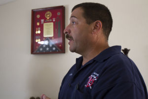 William Warneke : Northwest Fire District Captain Adam Golderg explains how Granite Mountain Hotshot and Yarnell Fire victim William Warneke left in the middle of doing restorations on his Marana house when he was called to fight the fire. - Randy Metcalf/The Explorer