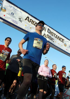 Arizona Distance Classic: Antonio Garcia set out on the Arizona Distance Classic half marathon Sunday.  - Randy Metcalf/The Explorer