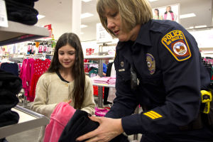 Shop With A Cop: Painted Sky Elementary School student Julie Lewelling shops at the Oro Valley Target with Jodi Stevens from the Oro Valley Police Department. Eighteen students were chosen from public and private schools to participate in the annual Shop-With-A-Cop event. - Hannah McLeod/The Explorer