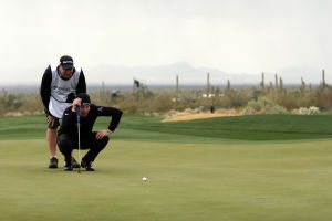 Accenture Match Play Championship: As a storm heads towards them, Stephen Gallacher and his caddie Richard Finch weigh their options on the ninth hole Wednesday.  - Randy Metcalf/The Explorer