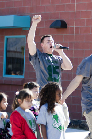 Canyon Del Oro Football Team's Hoodie Drive: CDO senior JJ Metz acted as an emcee during the hoodie donation at Prince Elementary School last week. - Randy Metcalf/The Explorer