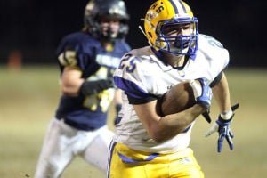 Marana Vs Flowing Wells Football: Marana's Bradley Gonzales takes the ball in for a touchdown during Friday night's game against Flowing Wells. The Tigers won 52-14. - Randy Metcalf/The Explorer
