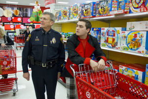 Shop With A Cop: Oro Valley Police Chief Danny Sharp helps 17-year-old, Josh Painter, find a stuffed animal for his niece. - Hannah McLeod/The Explorer