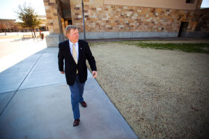 Ed Honea Hiking: Right out of his office, Town of Marana Mayor Ed Honea takes a walk around the block. Mayor Honea frequently hikes and power walks to stay in shape.  - J.D. Fitzgerald/The Explorer