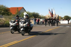 Oro Valley Holiday Parade 2014: Members of the Oro Valley Police Department lead the way to get the annual Oro Valley Holiday Parade under way. - Thelma Grimes/The Explorer