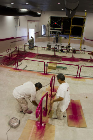 The Great American Playhouse: Brothers Tony Saucedo, left, and Juan Saucedo, with Paint Kings Company, paint the hang rail at The Great American Playhouse, in Oro Valley. - Randy Metcalf/The Explorer