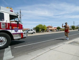 Don Kimball 3: Northwest resident Don Kimball salutes all first-responders, veterans, motorcyclists and any American flag he sees during his jogs.  - Randy Metcalf/The Explorer