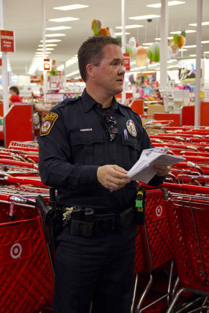 Shop With A Cop: Oro Valley Police Officer Kevin Mattocks headed up the Shop-With-A-Cop event. This event has occurred for more than 10 years. - Hannah McLeod/The Explorer
