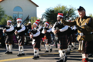 Oro Valley Holiday Parade 2014: There was plenty of entertainment throughout the parade, from the bagpipes being played above, to several local high school bands making the annual event. - Thelma Grimes/The Explorer