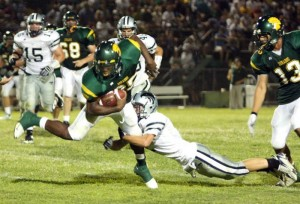 Dorados Claim OV Skirmish  : Randy Metcalf/The Explorer, Ironwood Ridge's Logan Bailey wraps up CDO running back Ka'Deem Carey during the fourth quarter of Friday night's contest. The touted Carey scored three times Friday, pacing the Dorados to a win over its crosstown rival before an overflowing crowd at CDO.