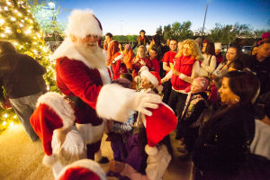 Oro Valley Holiday Tree Lighting Celebration: Santa Claus praises children at the Oro Valley 14th Annual Holiday Tree Lighting Celebration at the Oro Valley Marketplace on Dec.6. - J.D. Fitzgerald/The Explorer