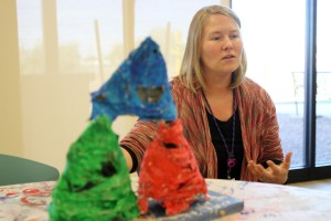 Art Therapist: Danielle Moss describes one of the student's projects from her art therapy class at the Marana Health Center.  - Randy Metcalf/The Explorer