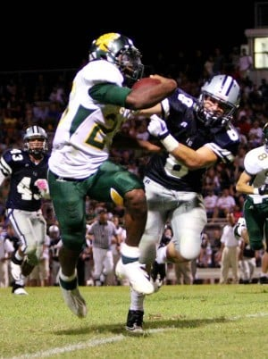 On Road, Dorados Fend Off Sabercats, 33-25 : Explorer file photo, CDO's Ka'Deem Carey, fighting through the tackle of Ironwood Ridge's Tyler Grammar in the late August season opener, scored twice and defended a late pass as the Dorados fended off Scottsdale Saguaro on the road Friday night.