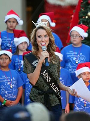 Marana Holiday Tree Lighting: Miss Arizona, Piper Stoeckel, emcees the Marana Holiday Festival and Christmas Tree Lighting ceremony Saturday.  - Randy Metcalf/The Explorer