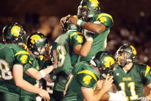 Under Glare, CDO Stays Unblemished  : J.D. Fitzgerald/Special to the Explorer, Canyon Del Oro's Josh Robbins (13) celebrates with Ka'Deem Carey after scoring a touchdown during the first half of Friday night's game. The Dorados went on to defeat Sabercats 34-21, making CDO the undefeated (10-0) 4A I Sonoran region champions.