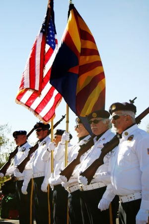 Oro Valley Holiday Parade 2014: The national and state flags are hoisted by local legion members. - Thelma Grimes/The Explorer