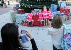 Marana Holiday Tree Lighting: Tucson Dance Academy Dancers, from left, Cailynn Cooper, Ainsley Cooper, Kasey Robertson and Jazmyn Martin have their pictures taken by Ammie Cooper, left and Suzanne Robertson in front of the Marana Christmas Tree.  - Randy Metcalf/The Explorer