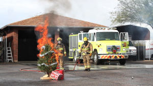 Safety Tips And Fire Demonstration From Rural/Metro Fire: Firefighters from Rural/Metro Fire Department watch a Christmas Tree burn in a demonstration to show how easily a fire could start in your home. Watch the video below. - J.D. Fitzgerald/The Explorer