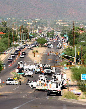 Monsoon Mayhem: Downed power lines are common during monsoon season. TEP officials warn residents to never touch them. Even though they are down, it does not mean they are not live. - Randy Metcalf/The Explorer