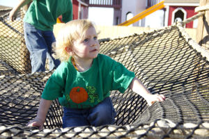 Marana Pumpkin Patch: Two-year-old Oaks Miller plays on the Spider Web. - Hannah McLeod/The Explorer