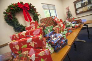 Give To Win: Numerous presents have been donated during the past month, which will be given away to families in need this holiday season. - Randy Metcalf/The Explorer