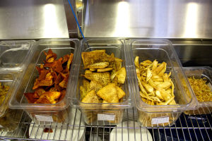 Pita Jungle: Pita chips are set to be served after just being prepared at Pita Jungle. - Hannah McLeod/The Explorer
