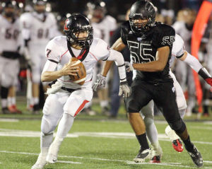 Mountain View Vs Liberty Football: Mountain View's Matt Thomas puts the pressure on Liberty's quarterback. - Randy Metcalf/The Explorer