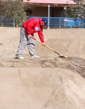 Xtreme Fun Spot At Sports Park: Krik Vaughn uses a shovel to smooth out the top of a jump on the new BMX course near Ina Road and Interstate 10.  - Randy Metcalf/The Explorer