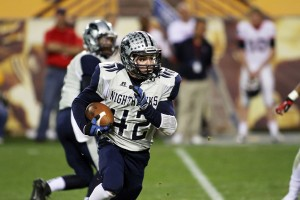 Ironwood Ridge Wins Division II State Football: Jake Vartanian contributed to the Nighthawks' rushing attack, rushing for six yards on the carry.  - Jon Grimes/Special to the Explorer
