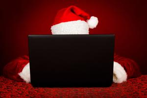 Santa Claus behind laptop