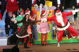 OV Church Of Nazarene Christmas Production: Santa, performed by Curtis Hodam, dances with Rudy who is performed by Ashley Coulter. - Oro Valley Church of the Nazaren