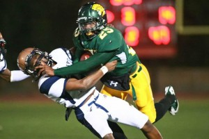 Not Done Yet  : J.D. Fitzgerald/Special to The Explorer, Canyon Del Oro running back Ka'Deem Carey plows over a Cienega defender Friday night.