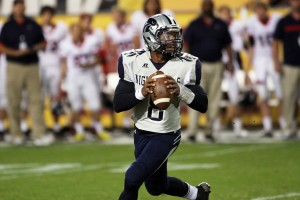 Ironwood Ridge Wins Division II State Football: Tyler Williams drops back to pass in a game where third-down conversional became the key to the Nighthawks' success.  - Jon Grimes/Special to the Explorer