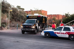 U Of A Gun Threat: Tucson Police Department Bomb Squad arriving on scene at the University of Arizona where a man was seen walking in the Administration building with a rifle.  - J.D. Fitzgerald/The Explorer