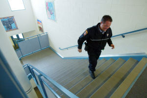 Oro Valley School Resource Officer Program: Oro Valley School Resource Officer Kevin Mattocks walks around the Wilson K-8 School in Oro Valley.  - Randy Metcalf/The Explorer