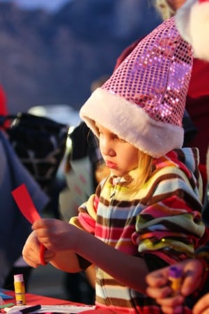 Oro Valley Holiday Tree Lighting: Mackenzie Shniderman, 6, puts together a Santa craft at one of the craft tables.  - Randy Metcalf/The Explorer