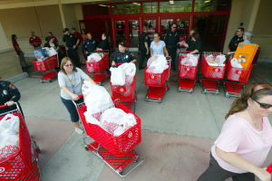 Annual Shop With A Teacher: After picking out much-needed school supplies, faculty members from each Oro Valley school leave the Oro Valley Target. - Randy Metcalf/The Explorer