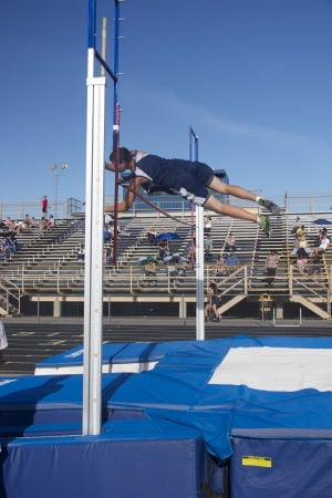 MHS Track: Garrett Turnbull flies over the bar at the pole vaulting event.  - Hannah McLeod/The Explorer