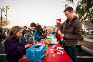 Oro Valley Holiday Tree Lighting Celebration: Volunteers helped children make holiday decorations. - J.D. Fitzgerald/The Explorer