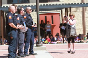 Born To Wear Blue: Patty Vallance, right, takes a photo of a group of Golder Ranch Fire District firefighters last week at Copper Creek Elementary School.  - Randy Metcalf/The Explorer