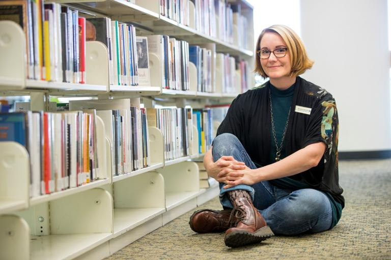 A leader between the book shelves