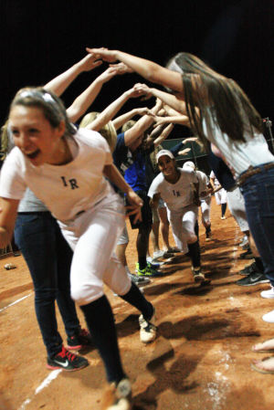 Ironwood Ridge Vs Canyon Del Oro Softball: Ironwood Ridge High School softball players run through a tunnel made by fans after they defeated CDO 4-0.  - Randy Metcalf/The Explorer
