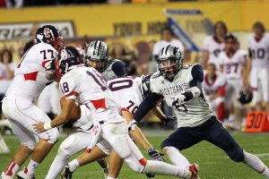 Ironwood Ridge Wins Division II State Football: Jake Matthews goes in for the sack. Matthews had one sack in the game, while the Nighthawks had six for the night.  - Jon Grimes/Special to the Explorer
