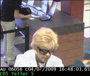 Bank robber in drag strikes in Northwest