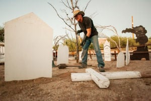 "Tomb Town: Keith Steward prepares his yard with Halloween decorations for his annual event, ""Tomb Town"" at his house, 8343 N. Wanda Road. The event, which Steward hosts to benefit the Arizona Food Bank, is held Oct. 31 from 5 to 10 p.m.  - J.D. Fitzgerald/The Explorer"