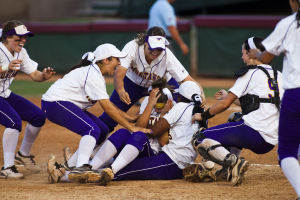 IRHS Goes To State: The Sunrise Mountain softball team piles on top of pitcher Taylor Nowlin Monday evening following their state championship victory over Ironwood Ridge.  - Jarod Opperman/10/13 Communicati