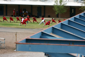 Falcon Football Jamboree: Middle school teams warm up for their games in the Falcon Football Jamboree at Marana Middle School. - Randy Metcalf/The Explorer