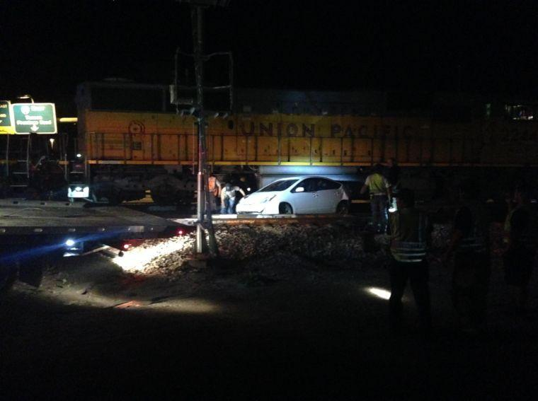 Ina road closed overnight after train hits disabled car