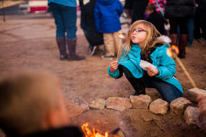 Oro Valley Holiday Tree Lighting Celebration: Kaylie Charters blows out a flaming marshmallow at the Oro Valley Holiday Tree Lighting Festival. - J.D. Fitzgerald/The Explorer